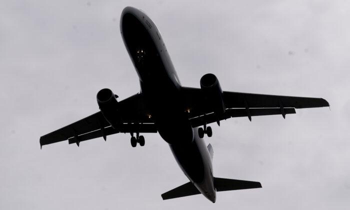 A JetBlue flight arrives at Salt Lake City International Airport on March 9, 2021. (Rick Bowmer/AP Photo)