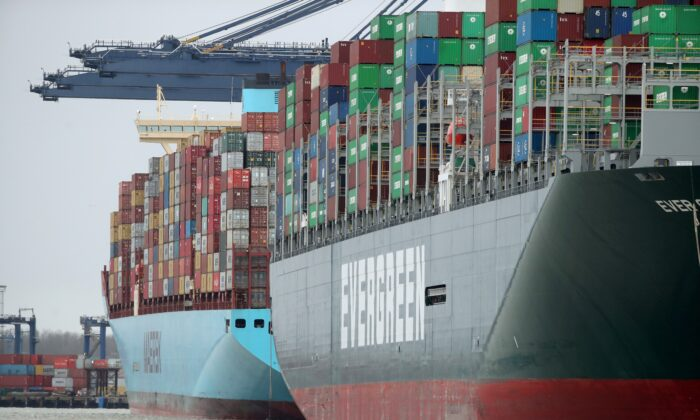 A view of the Port of Felixstowe, as containers are seen aboard the container ship Evergreen, in Felixstowe, Britain, on Jan. 28, 2021.  (Peter Cziborra/Reuters)