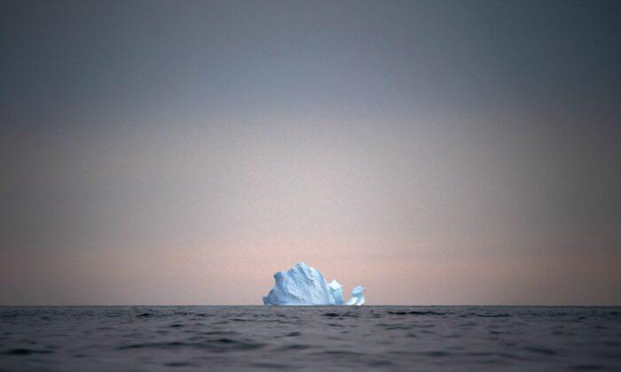 A large Iceberg floats away as the sun sets near Kulusuk, Greenland, on Aug. 15, 2019. (Felipe Dana/AP Photo)