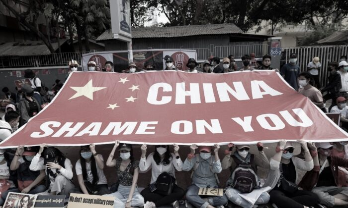 Demonstrators protest outside the Chinese embassy against the military coup in Yangon, Burma, on Feb. 19, 2021. (Stringer/Reuters)