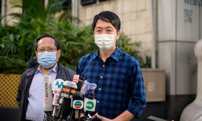 Former lawmaker from Hong Kong's pro-democracy opposition Ted Hui (R), accompanied by veteran pro-democracy politician Albert Ho (L), speaks to the media as he leaves the Western Police Station in Hong Kong on November 18, 2020. (Anthony Wallace/AFP via Getty Images)