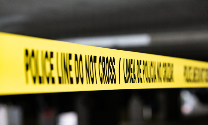 Crime scene tape in Santa Ana, Calif., on March 11, 2021. (John Fredricks/The Epoch Times)