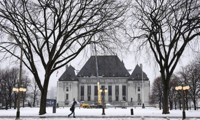 A pedestrian walks past the Supreme Court of Canada in Ottawa on Nov. 26, 2020. (Sean Kilpatrick/The Canadian Press)