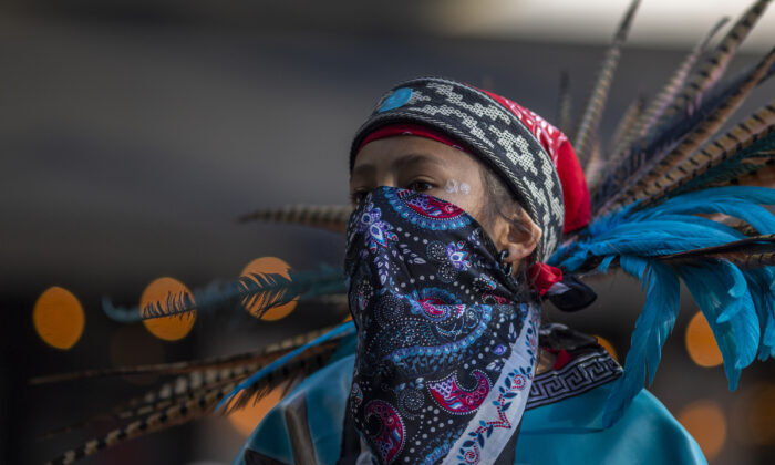 An Aztec dancer participates in a march in Los Angeles, California, on May 1, 2019. (David McNew/Getty Images)