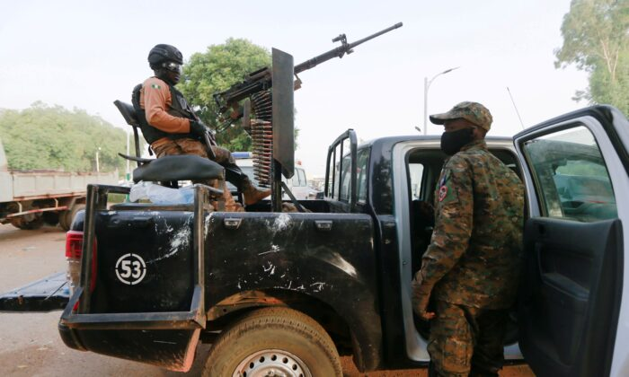 A soldier sits on one of the trucks used to bring back the girls who were kidnapped from a boarding school in the northwest Nigerian state of Zamfara, following their release in Zamfara, Nigeria, March 2, 2021. (Afolabi Sotunde/Reuters)