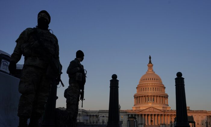 National Guard members stand their posts around the Capitol at sunrise in Washington, D.C., on March 8, 2021. (Carolyn Kaster/AP Photo)