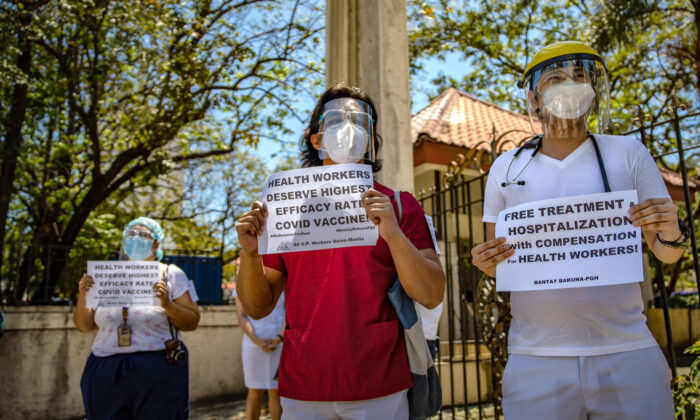 Healthcare workers protest being given Sinovac vaccine instead of Pfizer-BioNTech in Manila, Philippines, on Feb. 26, 2021. (Ezra Acayan/Getty Images)