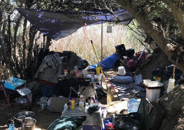 A group of homeless people living at Harriet Wieder Park and Bolsa Chica Conservancy were removed by Huntington Beach police's homeless task force on March 10 during a clearing operation. (Courtesy of the Huntington Beach Police Department)