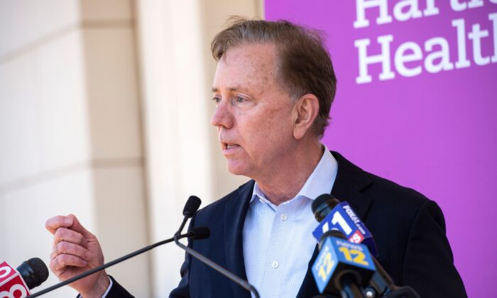 """Connecticut Governor Edward Miner """"Ned"""" Lamont Jr., a Democrat, speaks about the state's efforts to get more people vaccinated at Hartford HealthCare St. Vincent's Medical Center in Bridgeport, Conn., on Feb. 26, 2021. (Joseph Prezioso/AFP via Getty Images)"""