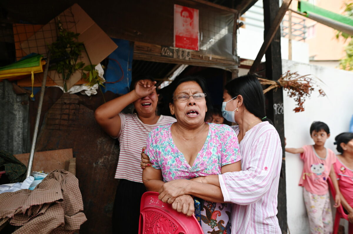 Family members of Aung Than, 41, who was killed during a raid by security forces cry at their home in Thaketa, Yangon