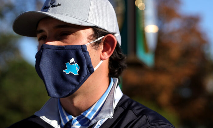 A staff member wears a Texas themed mask at Champions Golf Club, in Houston, Texas, on Dec. 9, 2021. (Carmen Mandato/Getty Images)
