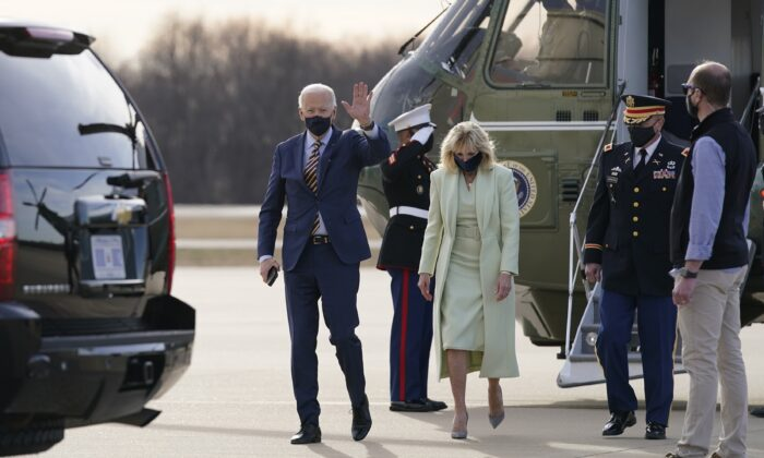 President Joe Biden and First Lady Jill Biden walk to a motorcade vehicle after stepping off Marine One at Delaware Air National Guard Base in New Castle, Del., on March 12, 2021. (Patrick Semansky/AP Photo)