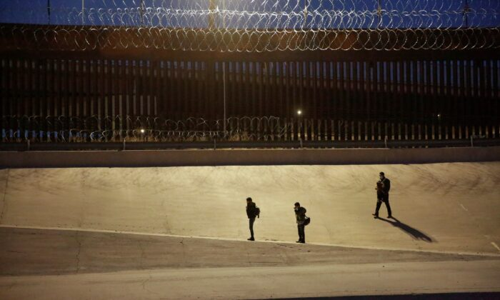 Migrants are seen after crossing the Rio Bravo river to turn themselves in to U.S. Border Patrol agents to request for asylum in El Paso, Texas, as seen from Ciudad Juarez, Mexico, on March 4, 2021. (Jose Luis Gonzalez/Reuters)
