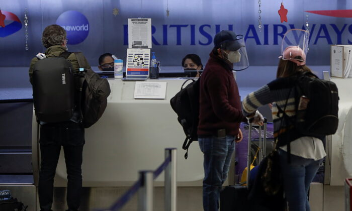 Passengers are seen at the counter of British Airways to check in for their flights to London at the Benito Juarez International Airport, in Mexico City, Mexico, on Dec. 21, 2020. (Luis Cortes/Reuters)