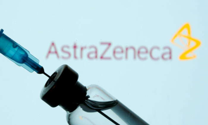 A vial and syringe in front of an AstraZeneca logo in this illustration taken on Jan. 11, 2021. (Dado Ruvic/Reuters)
