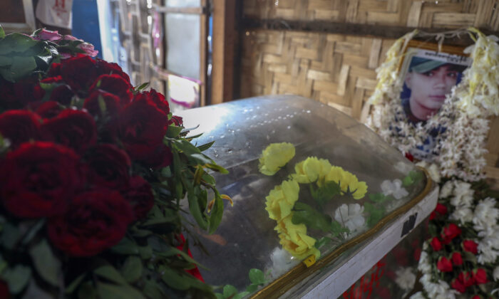 Body of Saw Pyae Naing is placed in a coffin at his home in Mandalay, Burma, on March 14, 2021. (AP Photo)