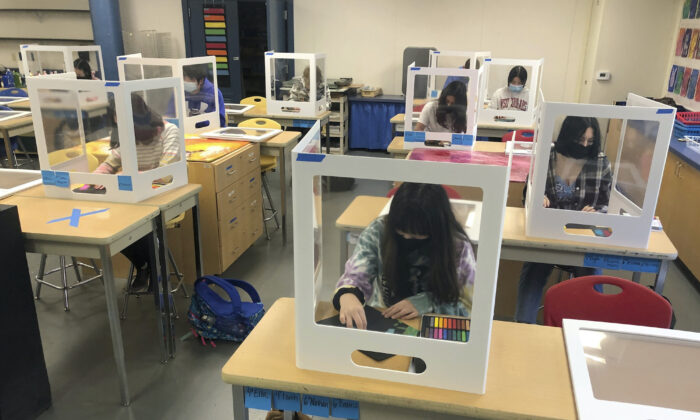 Socially distanced and with protective partitions, students work on an art project during class at the Sinaloa Middle School in Novato, Calif., on March 2, 2021. (Haven Daley/AP)