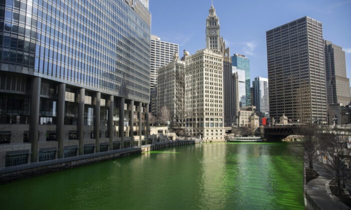 The Chicago River was dyed green ahead of St. Patrick's Day in Chicago, Ill., on March 13, 2021. (Pat Nabong/Chicago Sun-Times via AP)