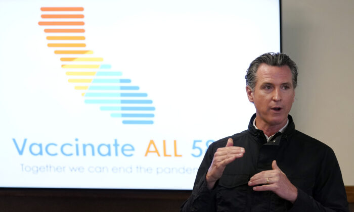 California Gov. Gavin Newsom addresses the media during a visit to a vaccination center in South Gate, Calif., on March 10, 2021. (Marcio Jose Sanchez/AP)
