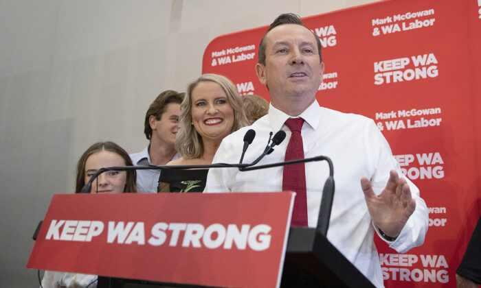 After a landslide victory, re-elected Premier of WA Mark McGowan makes a speech with his family by his side at the Gary Holland Community Centre  in Rockingham, Australia, on March 13, 2021. (Will Russell/Getty Images)