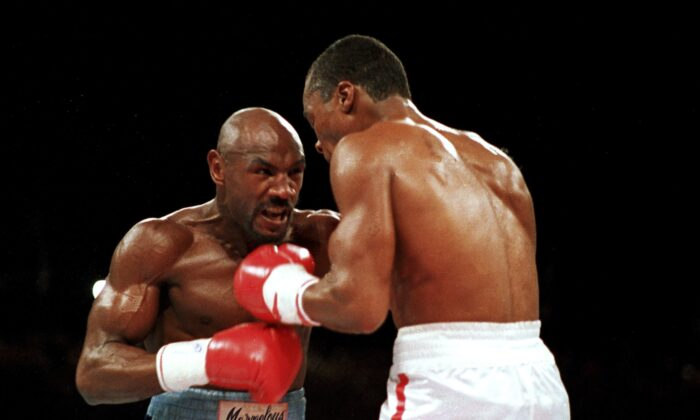 """Marvelous"" Marvin Hagler, left, moves in on ""Sugar"" Ray Leonard during the third round of a boxing bout in Las Vegas, on April 1987. (Lennox McLendon/AP Photo, File)"