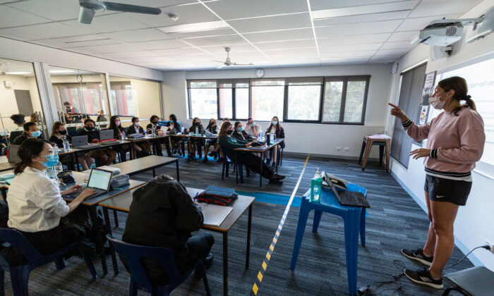 A teacher is seen wearing a mask in class at Melba Secondary College in Melbourne, Australia on Oct. 12, 2020. (Daniel Pockett/Getty Images)