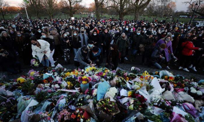 People gather, at the band stand in Clapham Common, in memory of Sarah Everard, after an official vigil was  cancelled, in London, on March 13, 2021. (Frank Augstein/AP Photo)