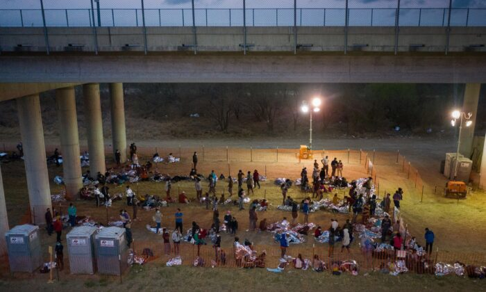 Illegal immigrants from Central America in a makeshift U.S. Customs and Border Protection processing center under the Anzalduas International Bridge after crossing the Rio Grande into the United States from Mexico in Granjeno, Texas, on March 12, 2021. (Adrees Latif/Reuters)