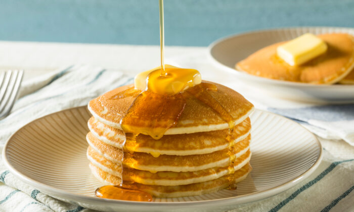 "My daughters call Jim's homemade syrup ""Pop's Sauce,"" after their name for their grandfather, and love to pour it over their pancakes with a generous side of sprinkles on Saturday mornings. (Brent Hofacker/Shutterstock)"