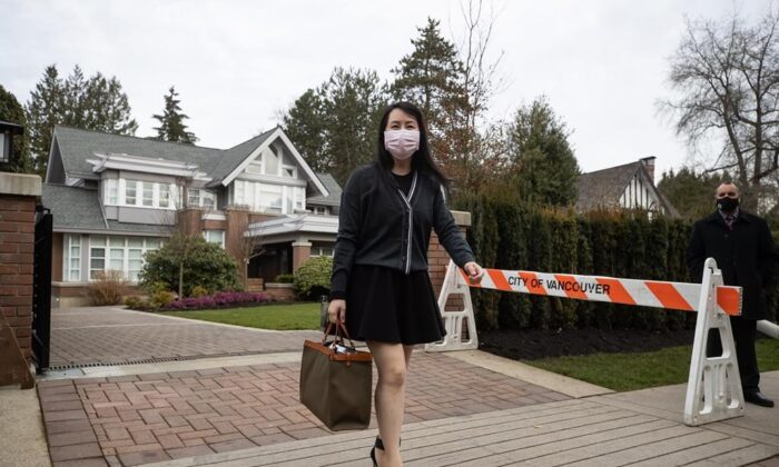 Meng Wanzhou, chief financial officer of Huawei, leaves her home to attend B.C. Supreme Court, in Vancouver, on March 4, 2021. (Darryl Dyck/The Canadian Press)