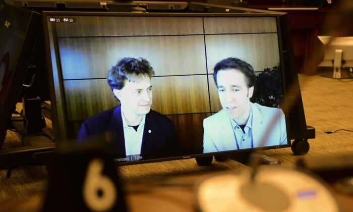Marc Kielburger, left, and Craig Kielburger, right, are pictured on CPAC as they appear as witnesses via videoconference during a House of Commons finance committee in Ottawa on July 28, 2020. The committee is looking into Government Spending, WE Charity and the Canada Student Service Grant. (Sean Kilpatrick/The Canadian Press)