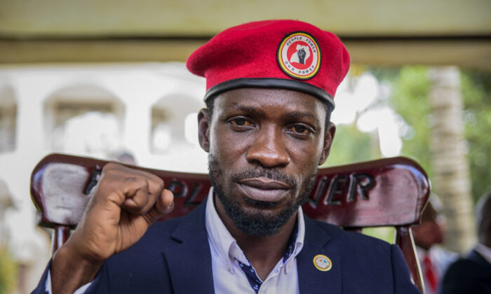 Opposition presidential challenger Bobi Wine, whose real name is Kyagulanyi Ssentamu, gestures as he speaks to the media outside his house after government soldiers withdrew from it, in Magere, near Kampala, in Uganda, on Jan. 26, 2021. (Nicholas Bamulanzeki, File/AP Photo)