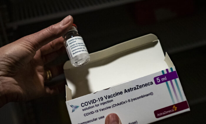 A member of medical staff shows the Oxford-AstraZeneca vaccine at the vaccinodrome set up in the Velodrome stadium in Marseille, France, on on March 15, 2021. (Arnold Jerocki/Getty Images)
