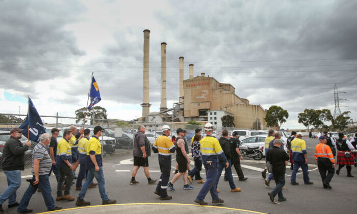 Workers leave Hazelwood Power Station after their final shift in Hazelwood, Australia on Mar. 31, 2017. Around 750 workers have been left jobless after the plant was closed. (Scott Barbour/Getty Images)
