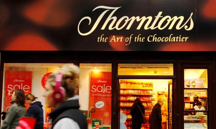 Customers shop at Thorntons chocolate shop on Oxford Street in London, on Jan. 11, 2012. (Luke MacGregor/Reuters)