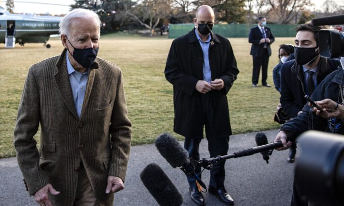 U.S. President Joe Biden stops to talk to the media after stepping off Marine One on the South Lawn of the White House on March 14, 2021. (Tasos Katopodis/Getty Images)