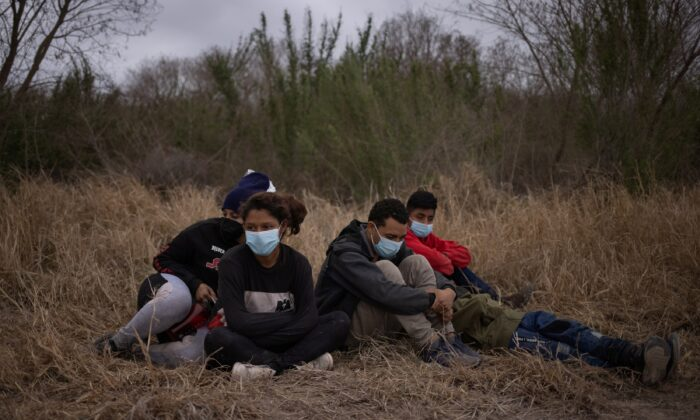 Unaccompanied minors from Central America are separated from other illegal border crossers by U.S. Border Patrol agents after crossing the Rio Grande river into the United States from Mexico on a raft in Penitas, Texas. on March 14, 2021. (Adrees Latif/Reuters)