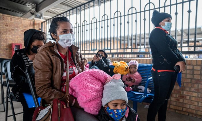 Immigrans wait for their bus at a bus station in Brownsville, Texas before traveling to meet relatives or sponsors, in Brownsville, Texas, on March 2, 2021. (Sergio Flores/AFP via Getty Images)