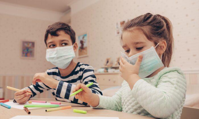 Stock image of children wearing masks. (L Julia/Shutterstock)