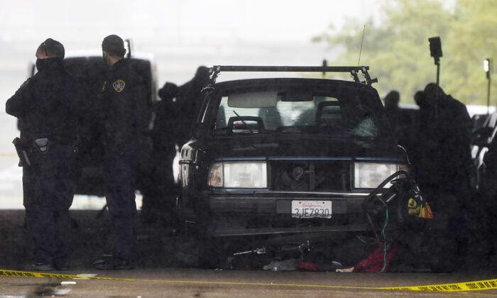 A car involved in a deadly accident sits at the scene, in San Diego, on March 15, 2021. (Gregory Bull/AP Photo)