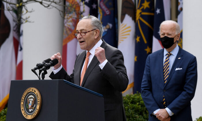 Senate Majority Leader Chuck Schumer (D-N.Y.) speaks outside the White House in Washington as President Joe Biden looks on, on March 12, 2021. (Olivier Douliery/AFP via Getty Images)