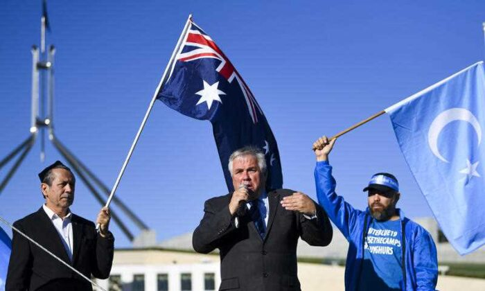 Independent Senator Rex Patrick speaks during a rally for the Uyghur community outside Parliament House in Canberra, Monday, March 15, 2021. (Lukas Coch/AAP)