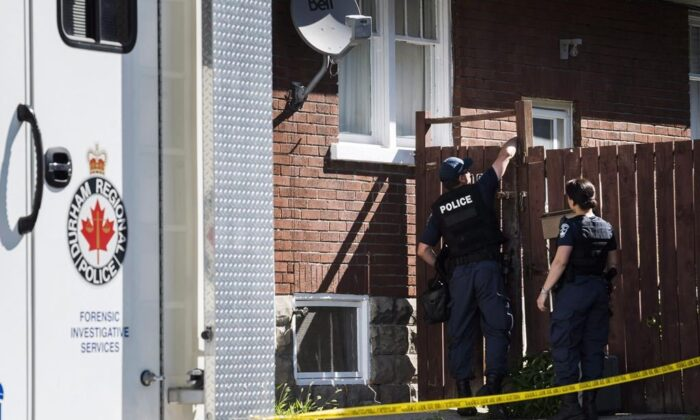 A Durham Regional Police forensics unit is seen in Oshawa, Ont., on July 10, 2018 outside a home where body parts were found in a basement apartment. (Christopher Katsarov/The Canadian Press)