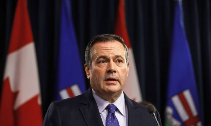 Alberta Premier Jason Kenney holds a press conference in Edmonton on March 20, 2020. (Jason Franson/The Canadian Press)