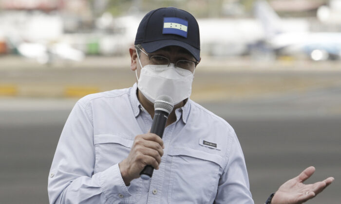 Honduran President Juan Orlando Hernandez during a ceremony at an air base to receive a shipment of the AstraZeneca COVID-19 vaccine via the COVAX program, in Tegucigalpa, Honduras, Saturday, March 13, 2021. (Elmer Martinez/AP Photo)