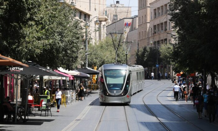 Jerusalem's light rail passes by in a central part of the city amid the spread of the coronavirus disease, on July 7, 2020. (Ammar Awad/Reuters)