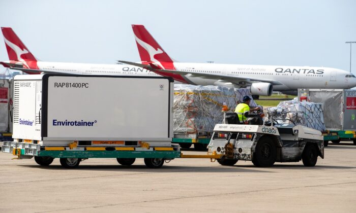 Container RAP81400PC  is transported away from the plane at Sydney International airport in Sydney, Australia, on Feb. 28, 2021. (Edwina Pickles - Pool/Getty Images)
