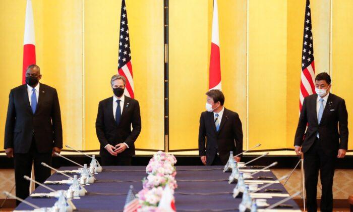 Secretary of State Antony Blinken, U.S. Defense Secretary Lloyd Austin, Japan's Foreign Minister Toshimitsu Motegi, and Japan's Defense Minister Nobuo Kishi attend the 2+2 Meeting at Iikura Guest House in Tokyo, Japan, on March 16, 2021. (Kim Kyung-Hoon/Pool/Reuters)