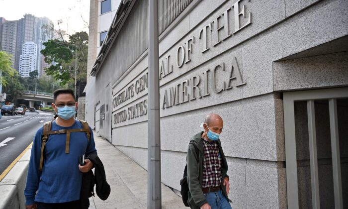 People walk past the U.S. consulate building in Hong Kong, China, on March 15, 2021. (Peter Parks/AFP via Getty Images)