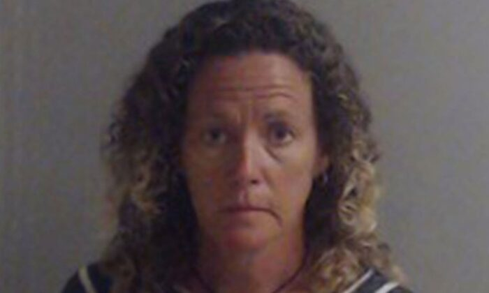 Laura Rose Carroll, 50, in booking photo. (Escambia County Jail)